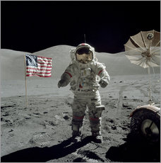 Mark Stevenson - Apollo 17 astronaut stands near the American flag on the lunar surface.