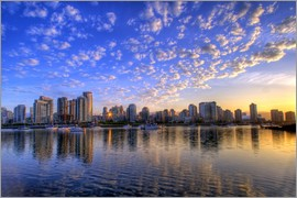 Chuck Haney - Blue sky at sunrise over the skyline of Vancouver