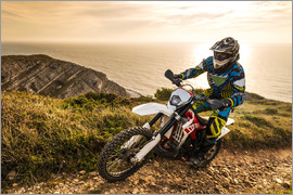 Enduro rider on a coastal road