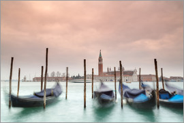 Click Alps - Europe, Italy, Veneto, Venice. Gondolas tied up to wooden poles on the Canal Grande, in the backgrou