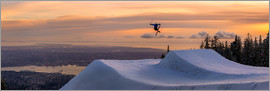 Tyler Lillico - Freestyle skier doing a trick off a jump above city at sunset, Canada, North America