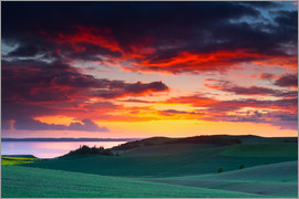 Mark Scheper - Rolling green hills and lake at sunset