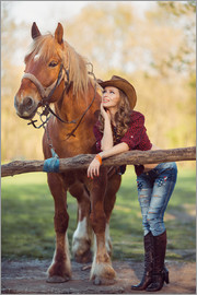 young cowgirl and horse