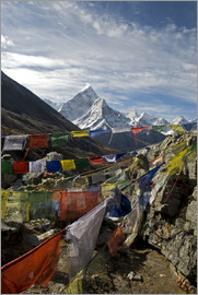 David Noyes - Nepal. Prayer flags are hung along the Everest Base Camp Trail with the peak of Ama Dablam in the ba