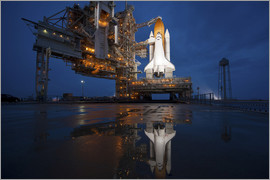 Night view of space shuttle Atlantis on the launch pad at Kennedy Space Center, Florida.