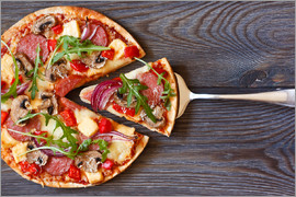 Pizza with salami and arugula