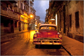 Lee Frost - Red vintage American car parked on a floodlit street in Havana Centro at night, Havana, Cuba, West I