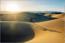 Image Source - Runner sprinting in desert, Death Valley, California, USA