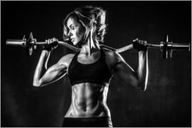 Sportswoman with a barbell
