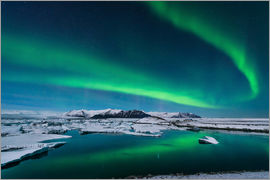 John Davis - The northern lights dance over the glacier lagoon in Iceland.