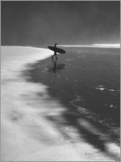 A lone surfer on his way into the sea.