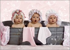Toddlers in flowery bonnets