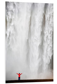 Hartschaumbild  Woman in red jacket standing in front of Skogafoss waterfall, South Iceland, Iceland, Polar Regions - Lee Frost