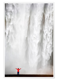 Premium-Poster Woman in red jacket standing in front of Skogafoss waterfall, South Iceland, Iceland, Polar Regions
