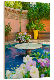 Holzbild  Fountain and flowers in the Majorelle Gardens (Gardens of Yves Saint-Laurent), Marrakech, Morocco, N - Matthew Williams-Ellis