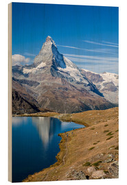 Holzbild  Hikers walking on the path beside the Stellisee with the Matterhorn reflected. Zermatt Canton of Val - Roberto Moiola