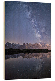 Holzbild  A sharp Milky Way on a starry night at Lac des Cheserys with Mont Blanc, Europe's highest peak, to t - Roberto Moiola
