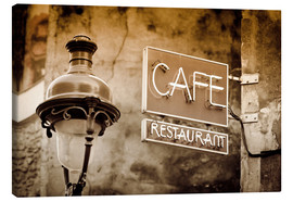 Leinwandbild  Cafe sign and lamp post, Paris, France. - age fotostock
