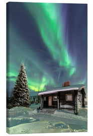 Leinwandbild  Northern Lights frame a wooden hut - Roberto Moiola